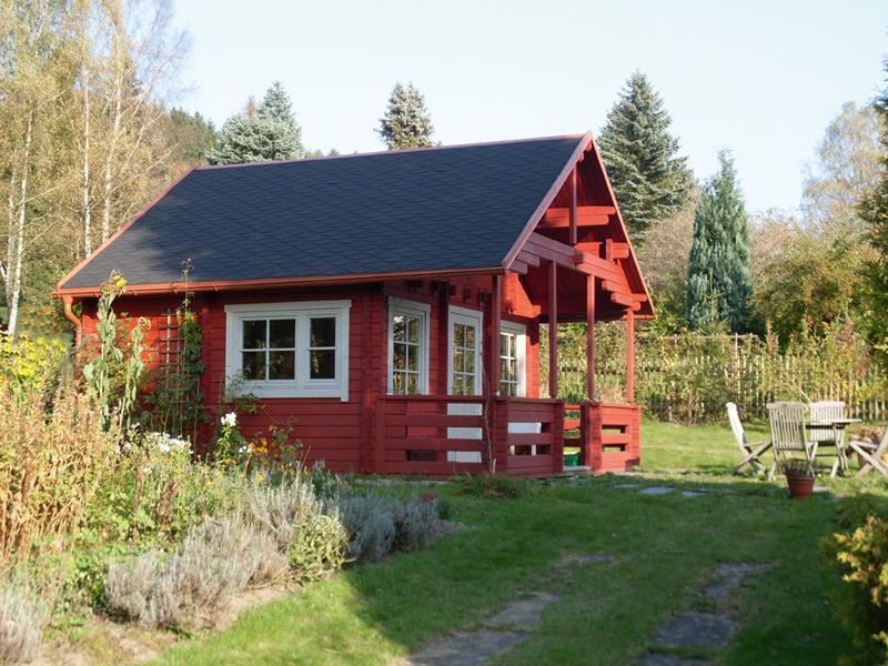 Wolff Finnhaus Ferienhaus aus Holz 70mm Blockbohlenhaus Sauerland 70-B