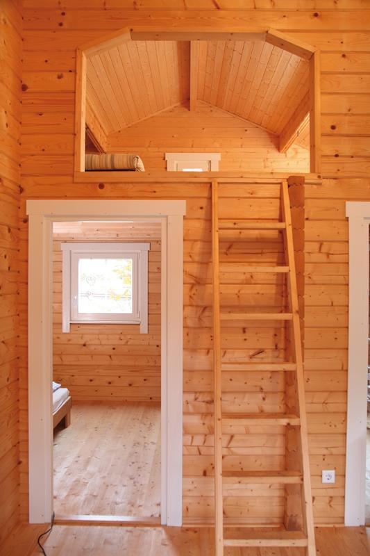 Wolff Finnhaus Ferienhaus aus Holz 70mm Blockbohle Spessart 92-E mit Schlafboden