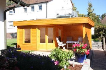 Wolff Finnhaus Holz-Gartenhaus Flachdachhaus Maja 40-A - 40 mm - mit Terrasse 250